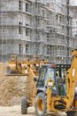 Excavator on a construction site. Building in progress. Architec Royalty Free Stock Photo