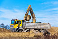 Excavator at construction work on site Stock Photos