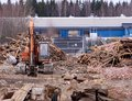 Excavator at demolition site breaking down the building Royalty Free Stock Photo