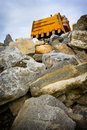 Excavator detail on top of stones Stock Images
