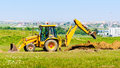Excavator digging hole Royalty Free Stock Photo