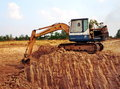 An excavator digs a pond khon buri nakhon ratchasima thailand march on agricultural land on march in khon buri in nakhon Stock Images