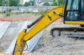 Excavator on the excavation large backhoe construction site boundary at Stock Photography
