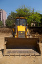 Excavator loader with backhoe front view Stock Images