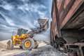 Excavator loader with backhoe works wheel unloading clay Stock Photography