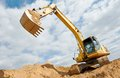 Excavator loader at earthmoving works machine excavation work in sand quarry Royalty Free Stock Photo