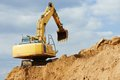 Excavator loader at earthmoving works machine excavation work in sand quarry Stock Photography