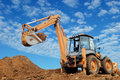 Excavator Loader with rised backhoe Stock Photography