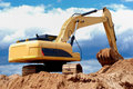 Excavator loader in sandpit Royalty Free Stock Image