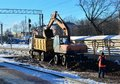 Excavator loads crushed stone in a dump truck body. Construction of the railway. Preparing the surface of the earth for laying Royalty Free Stock Photo