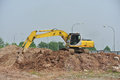 Excavator machine used to excavate soil at the construction site selangor malaysia january excavators is heavy do excavation work Royalty Free Stock Image