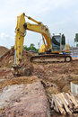 Excavator machine used to excavate soil at the construction site selangor malaysia – september excavators is heavy do excavation Stock Images