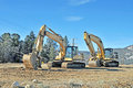 Excavator these machines are two caterpillar excavators used in preparing a site for construction the in the foreground has a Stock Images
