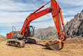 Excavator mountain construction caterpillar in central asia Stock Photography