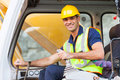 Excavator operator cheerful on construction site Royalty Free Stock Photo
