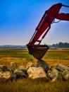 Excavator Puts it Bucket Down Royalty Free Stock Photo
