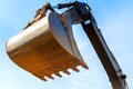 Excavator scoop bucket across the blue sky Stock Photo
