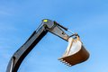 Excavator scoop bucket across the blue sky Stock Images