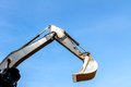 Excavator scoop bucket across the blue sky Royalty Free Stock Photography