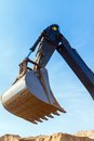 Excavator scoop bucket across the blue sky Stock Photography