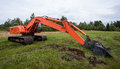 Excavator on a summef field Stock Photography