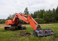 Excavator on a summef field Royalty Free Stock Photos