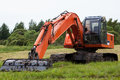 Excavator on a summer field Royalty Free Stock Photos