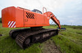 Excavator on a summer field Stock Photo