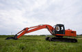 Excavator on a summer field Stock Images