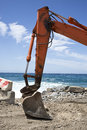 Excavator on the sunny beach orange Royalty Free Stock Photo