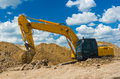Excavator in trench construction scenery Royalty Free Stock Image