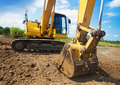 Excavator working at construction site h Royalty Free Stock Images