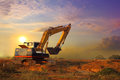 Excavator working and moving earth in construction afternoon Royalty Free Stock Photo
