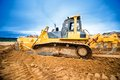 Excavator working and moving earth in construction site Royalty Free Stock Photo