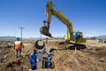 Excavator working on road. Royalty Free Stock Photo