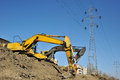 Excavators excavating on site Royalty Free Stock Photo