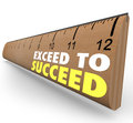 Exceed to succeed extra credit above and beyond ruler the words on a wooden from school illustrate getting or going expections Royalty Free Stock Images