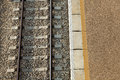 Excerpts of railway track and train station platform as viewed from directly above Royalty Free Stock Image