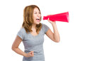 Excite woman shout with megaphone isolated on white background Royalty Free Stock Photo