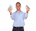 Excited adult man holding cash money portrait of an looking at you and against white background Royalty Free Stock Photo