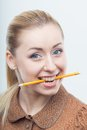 Excited attractive woman biting pencil beautiful blond business isolated on white background holding in her mouth Royalty Free Stock Image