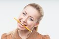 Excited attractive woman biting pencil beautiful blond business isolated on white background holding in her mouth Stock Photography