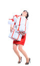 Excited attractive woman with many gift boxes and bags Stock Image