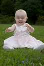 image photo : Excited baby discovers grass