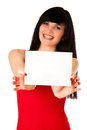 Excited beautiful young woman showing a blank paper isolated over white Royalty Free Stock Photo