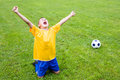 Excited boy football player after goal scored Stock Photos