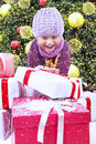 Excited boy open Christmas gift under tree in snow Stock Images