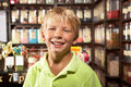 Excited Boy Standing In Sweet Shop Stock Photography