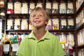 Excited Boy Standing In Sweet Shop Royalty Free Stock Image