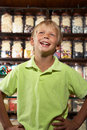 Excited Boy Standing In Sweet Shop Royalty Free Stock Images